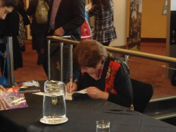 Emily Rodda signs books at the Schools Programme
