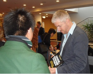 Anthony McCarten signs books at the Schools Programme