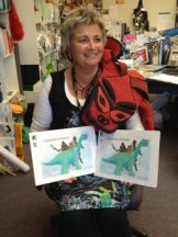 Photo of Kirsten holding Maori and English versions of Taniwha Taniwha