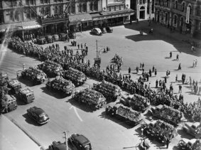 Trucks with wreaths in Cathedral Square, Christchurch, during the funeral service for victims of the Ballantyne's Department Store fire,. New Zealand Free Lance : Photographic prints and negatives. Ref: PAColl-7171-90. Alexander Turnbull Library, Wellington, New Zealand. http://natlib.govt.nz/records/22739444