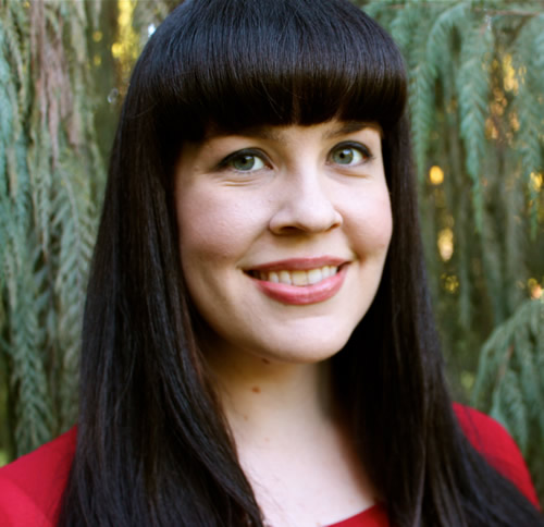 Caitlin_Doughty_in_red_evergreen_background