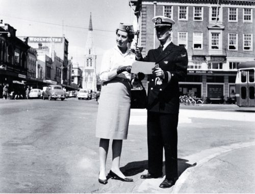 Male and female cabin crew of TEAL standing at the corner of Colombo and Armagh Streets [ca. 1960] CCL PhotoCD 11, IMG0044