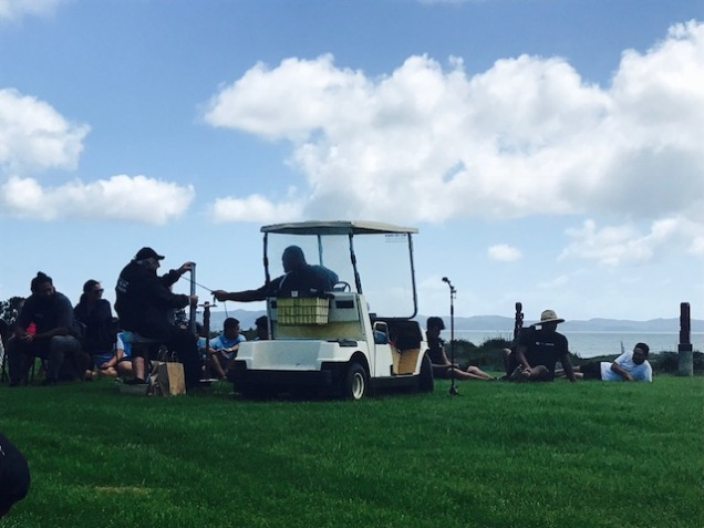 Heke-Nuku-Mai-Nga-Iwi Busby sitting next to his golf cart