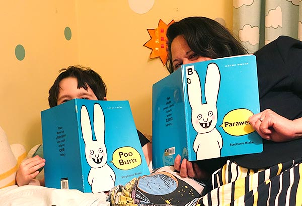 Mother and son read Poo bum and Paraweta together